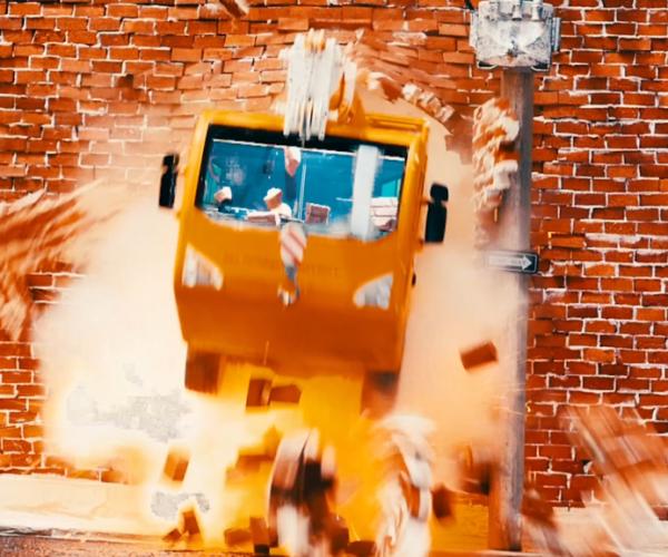 The Big Movie Company advert crane exploing through wall